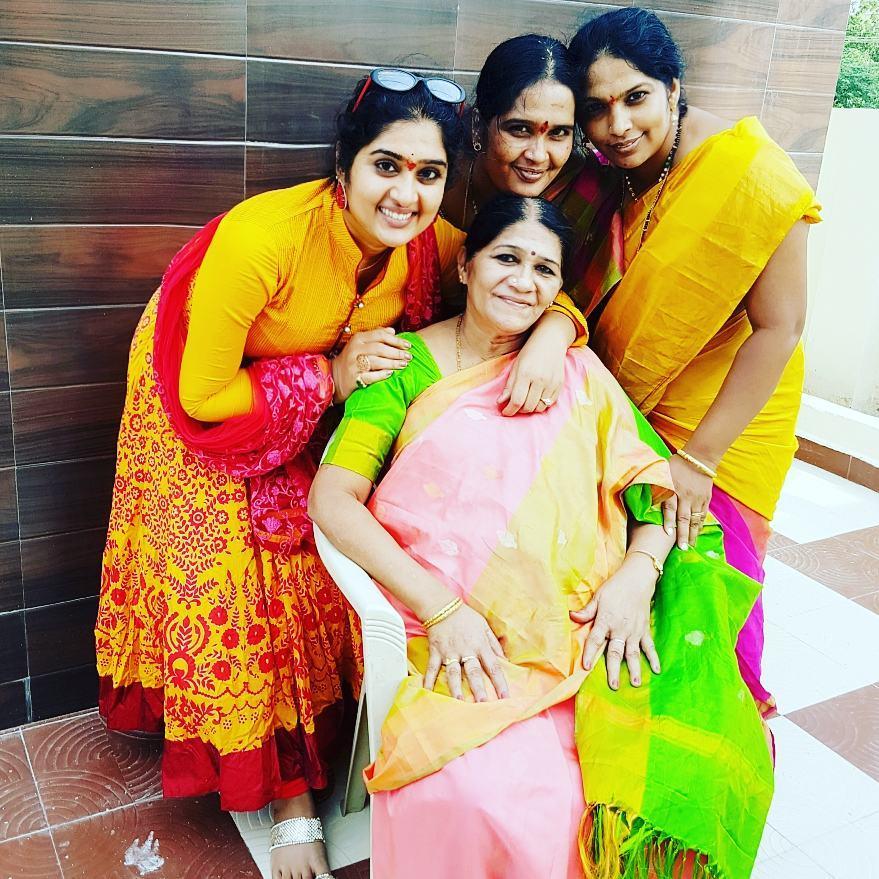 Priya with her Mom and Sisters